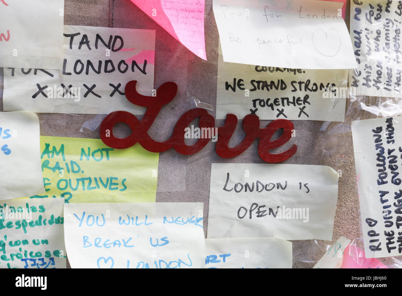 London UK. 11th June 2017. Members of the public view the messages of condolence on a wall in London Bridge . It Stock Photo