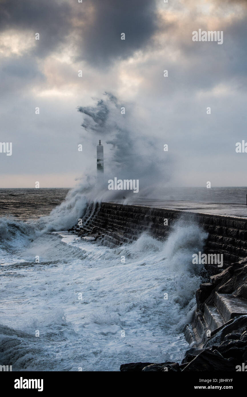 Aberystwyth Wales UK, Sunday 11 June 2017 UK Weather: Unseasonal gale force winds and high tides combine to bring Stock Photo