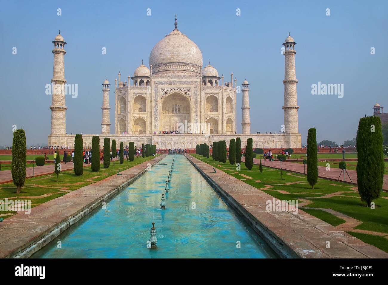 Taj Mahal with reflecting pool in Agra, Uttar Pradesh, India. It was build in 1632 by Emperor Shah Jahan as a memorial - Stock Image