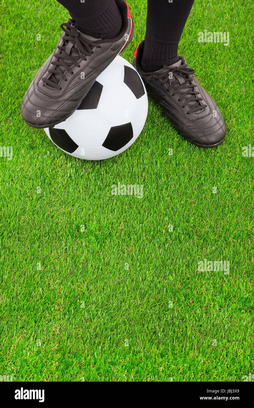 4ecc71cc279 Soccer player s feet and football on field Stock Photo  144842385 ...