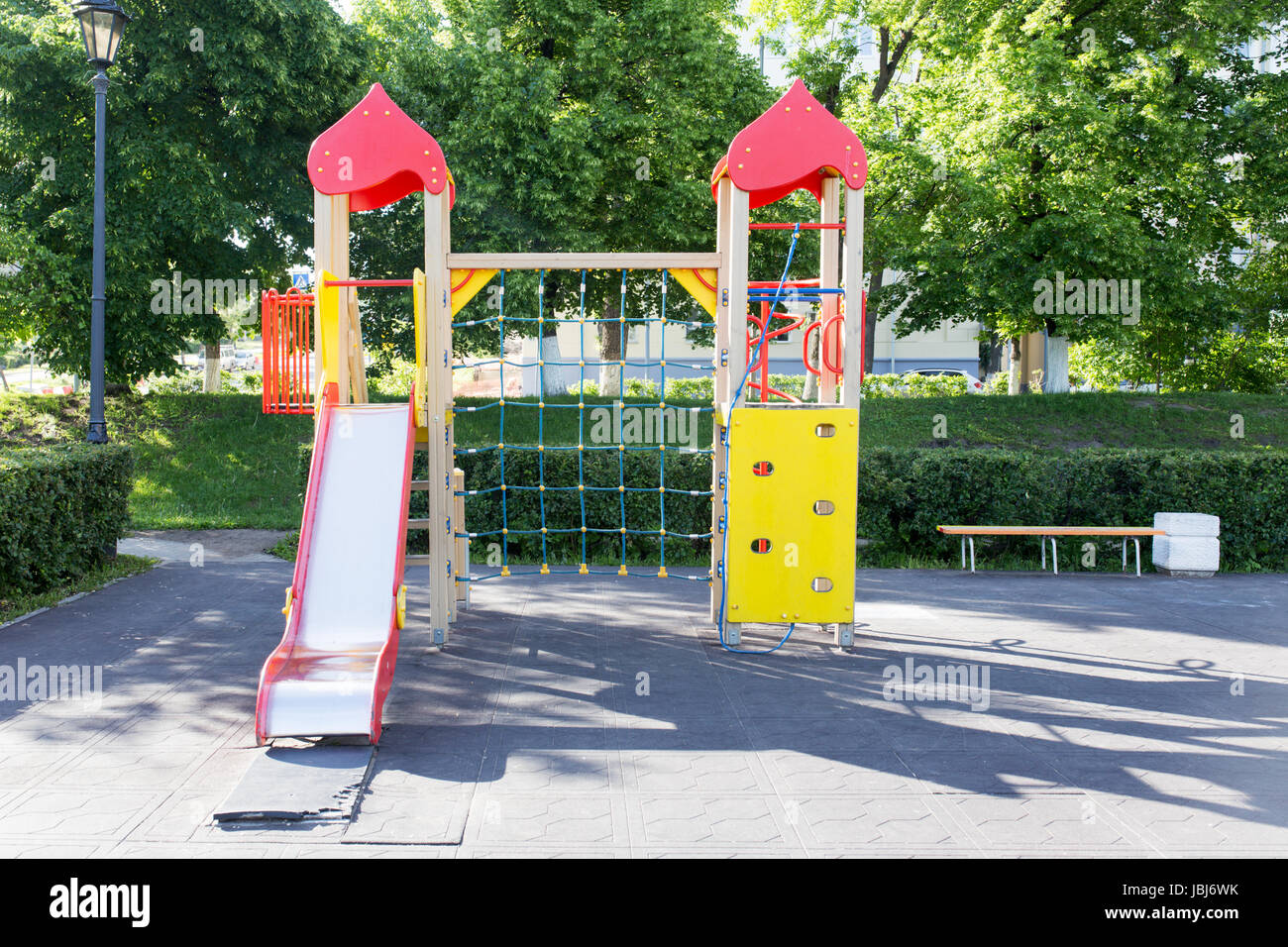 Modern Playground Equipment. Modern Colorful kids playground on yard in the park. image for background of playground, - Stock Image