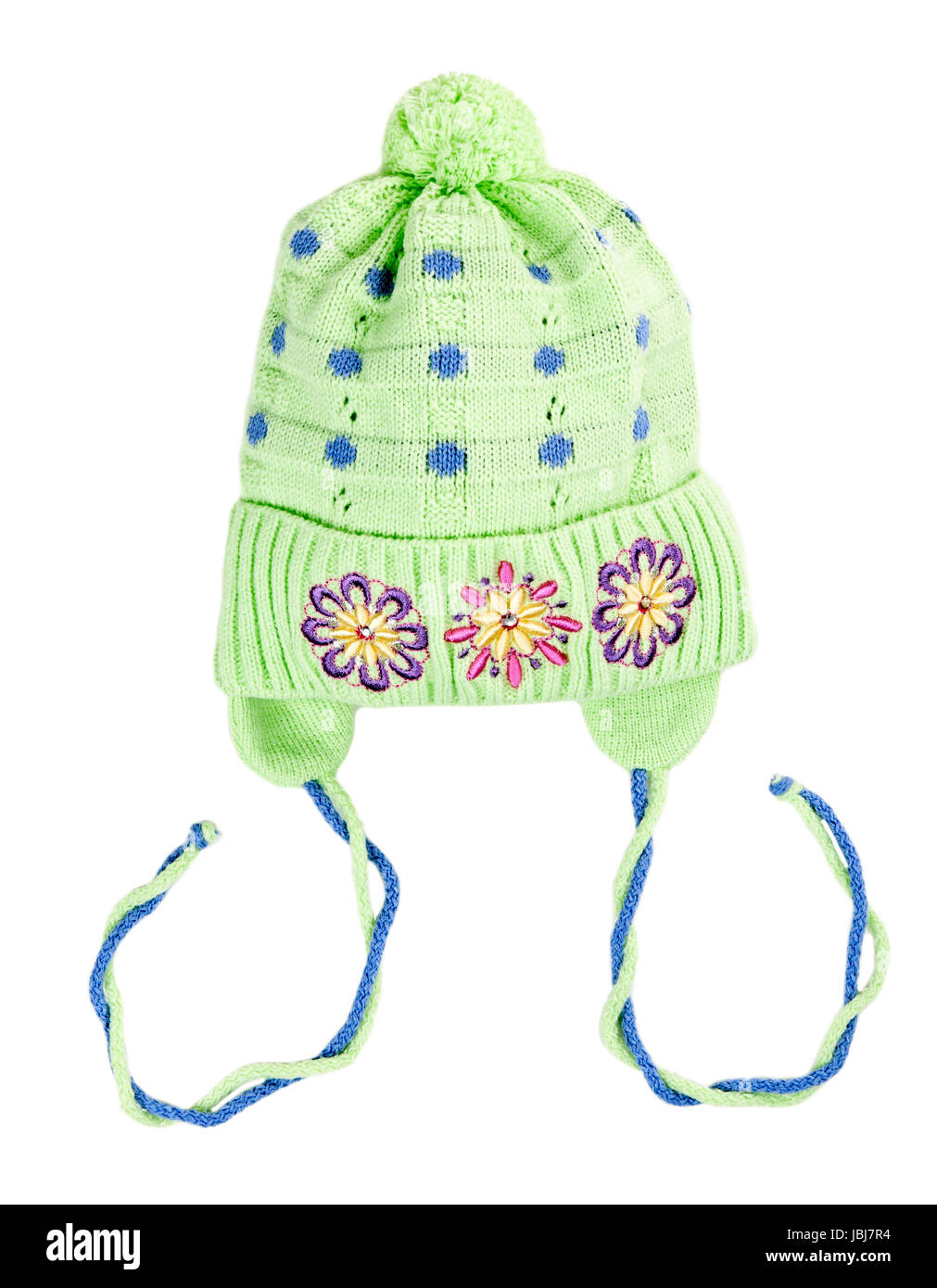green baby knitted hat with a flower pattern on a white background ...