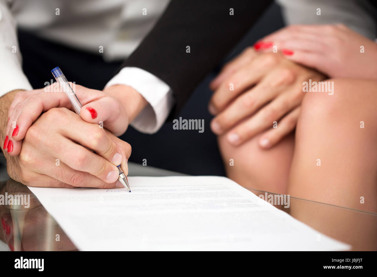 Man singning marriage settlement, prenuptial agreement, rich woman pulling into it Stock Photo