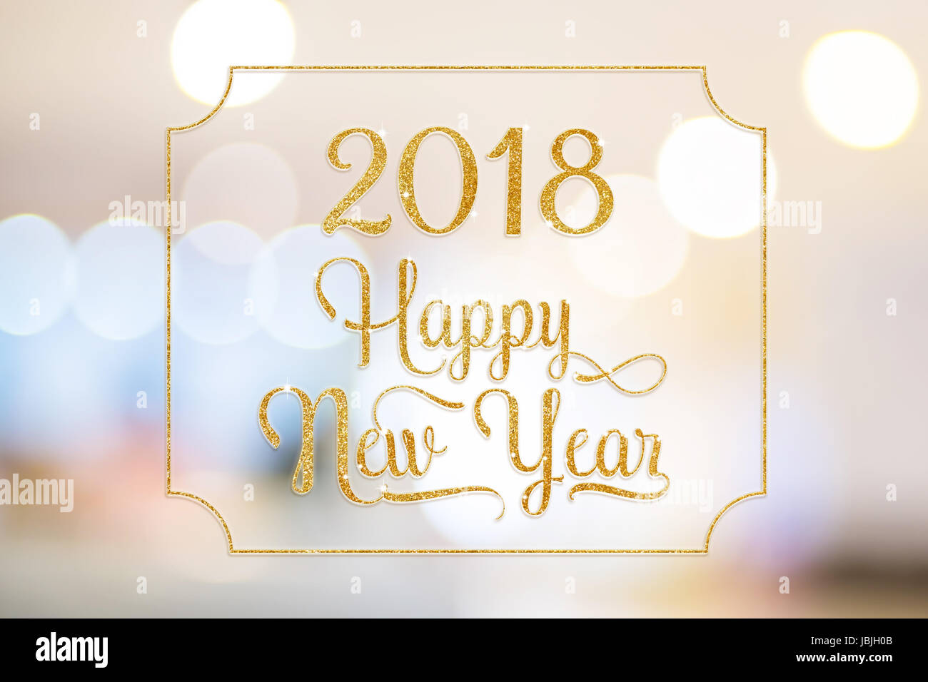 happy new year 2018 gold sparkling glitter word with golden frame at abstract blurred bokeh light background holiday concept