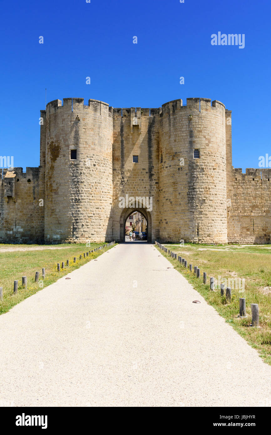 Porte des Moulins, one of the old medieval town gateways of Aigues Mortes, Gard, Occitanie, France - Stock Image