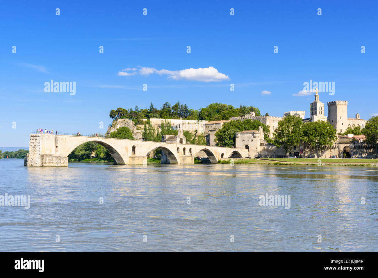 Medieval city views and the four remaining arches of Avignon bridge, the Pont Saint-Bénézet from the Rhone - Stock Image