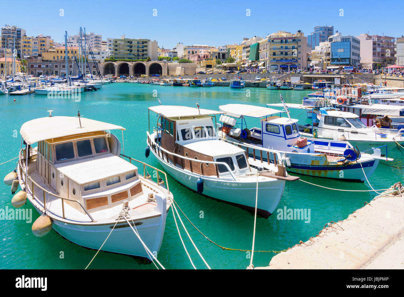 Moored fishing boats in the old Venetian Harbour of Heraklion, Crete, Greece - Stock Image
