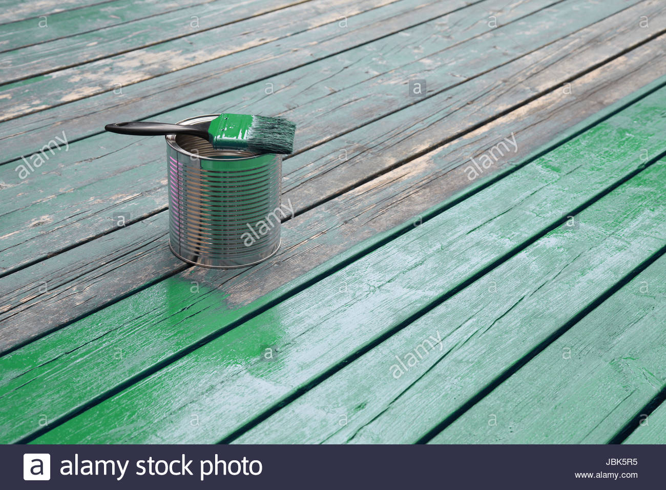 Freshly Painted Wooden Terrace In Green Paint Can With Brush