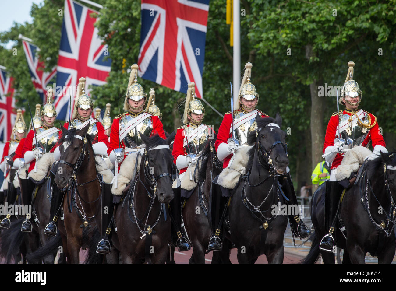 Household cavalry parade along The Mall, London - Stock Image