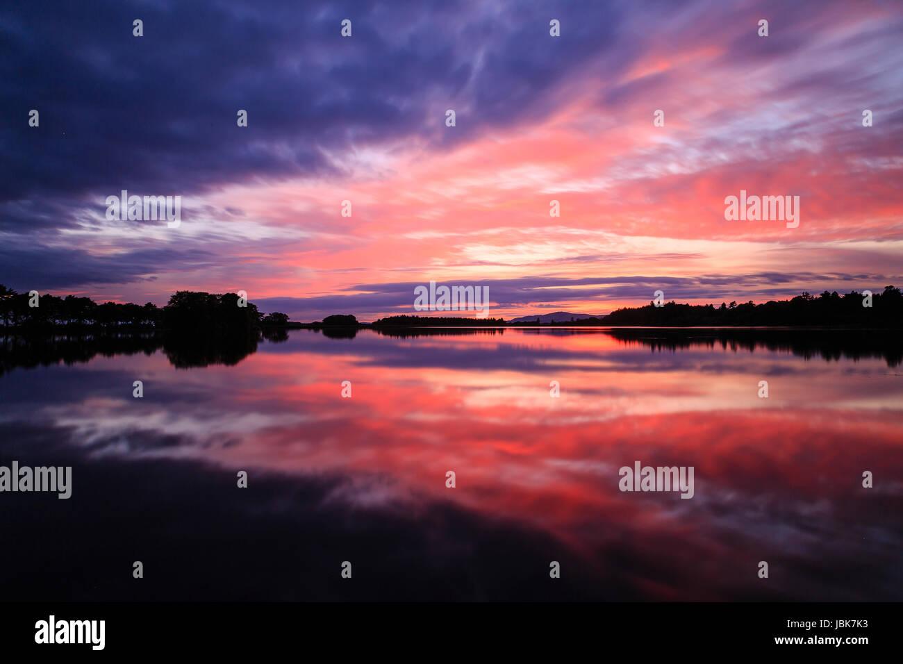 A wonderful sunset at Monikie Reservoir, Angus - Stock Image