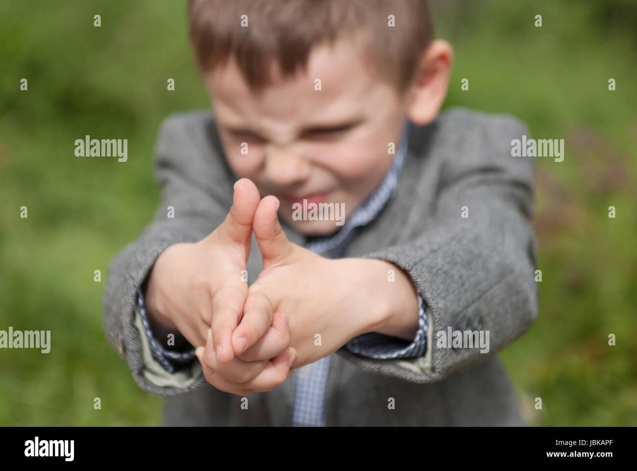 Little boy imitates a gun - Stock Image