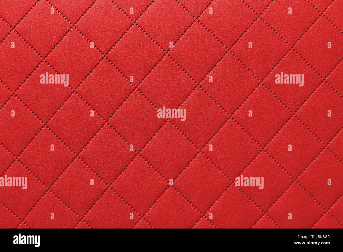 detail of sewn leather, red leather upholstery background pattern - Stock Image
