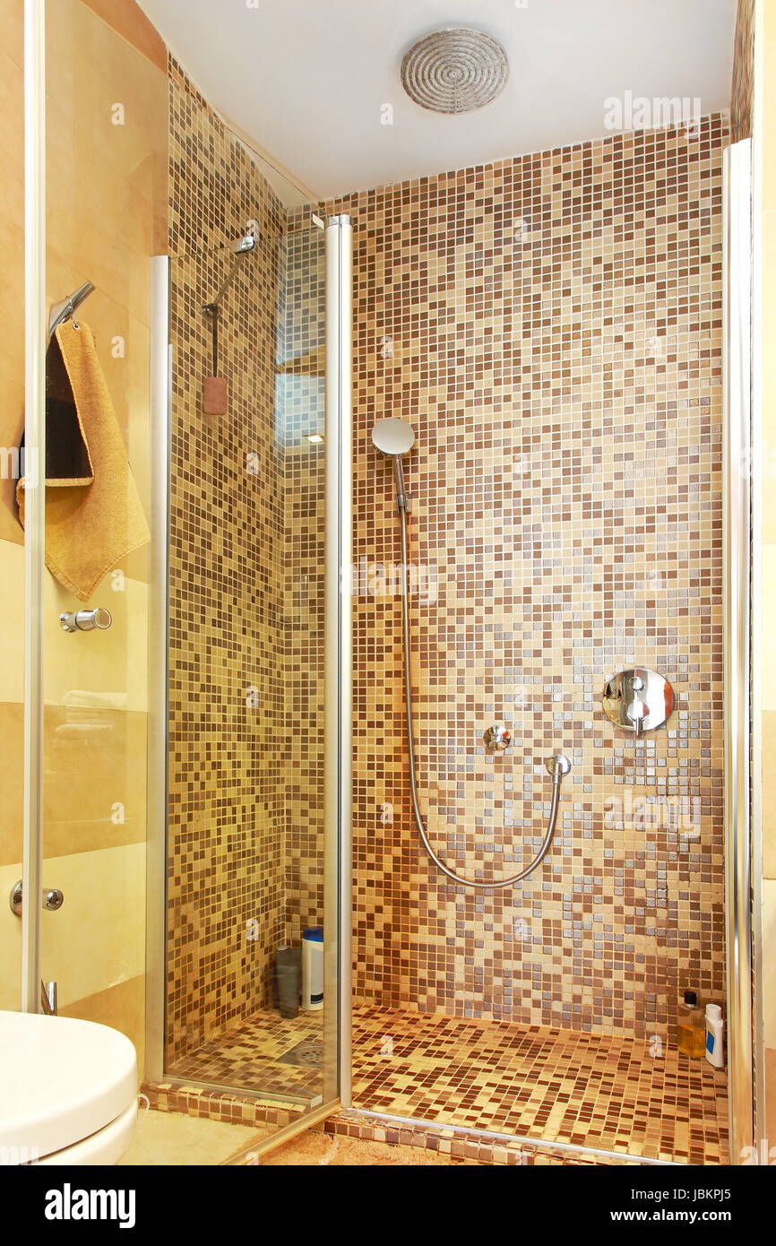 Shower cabin with mosaic tiles and glass door Stock Photo: 144879005 ...