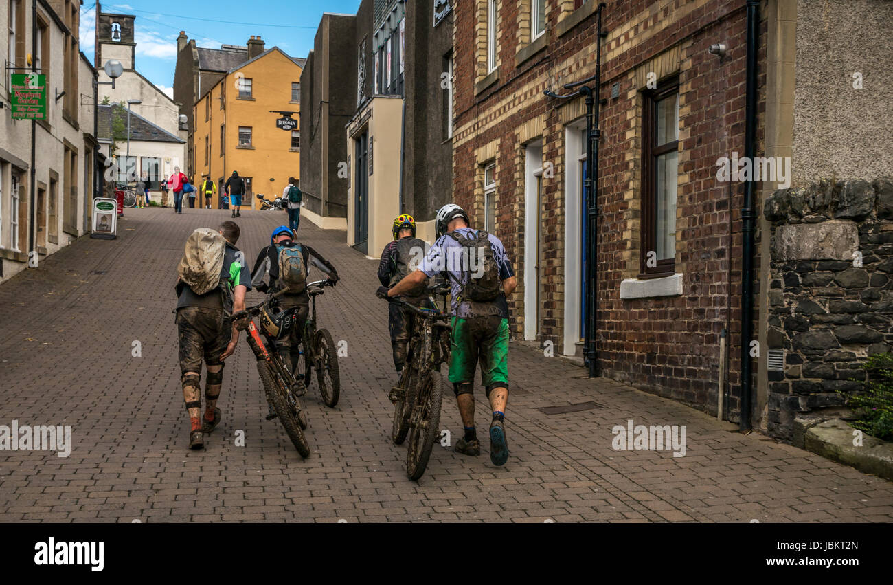 Group of muddy mountain bikers after cycling event at Tweedlove Cycling Festival 2017, Peebles, Scottish Borders, - Stock Image