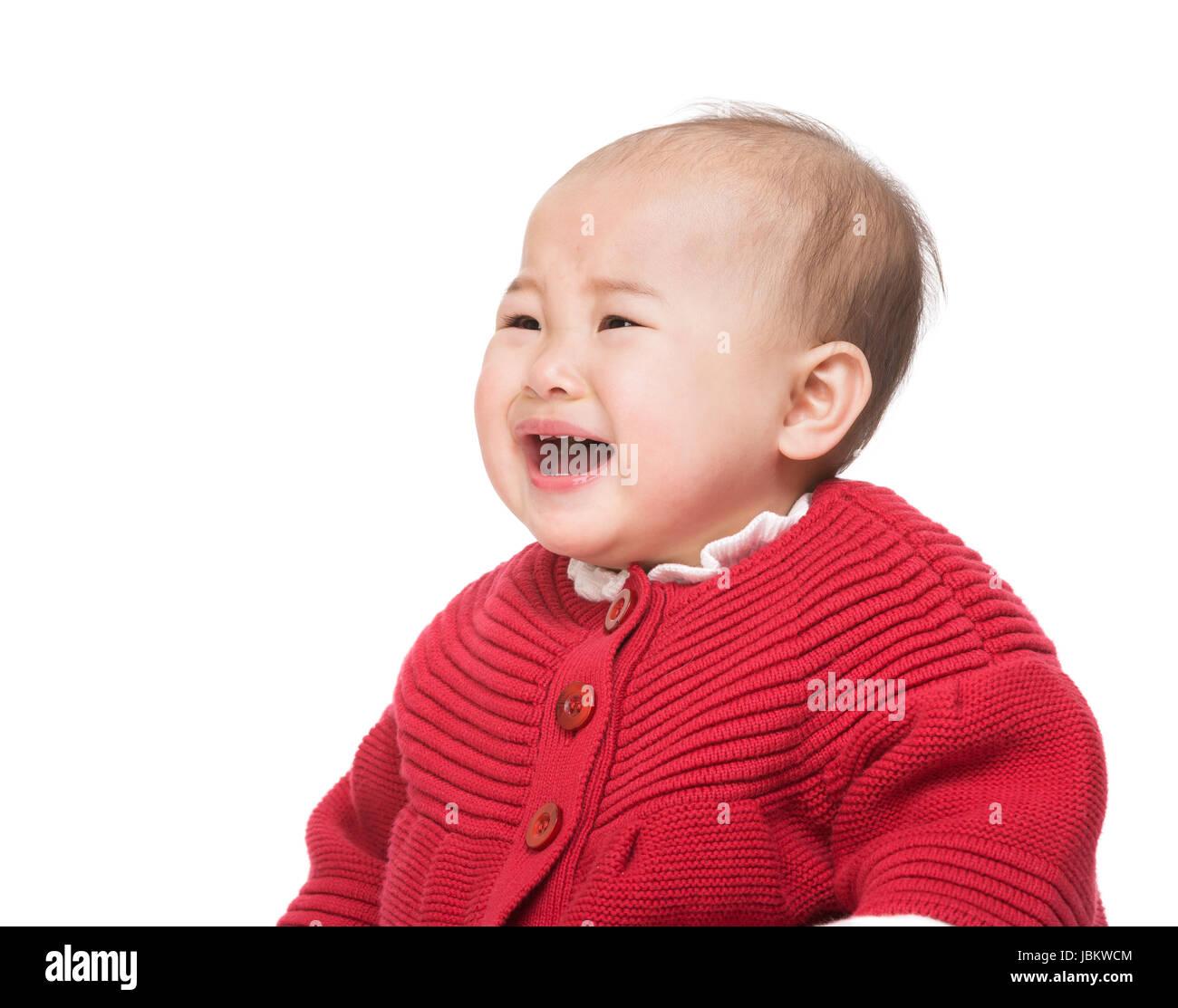 Crying asian baby girl - Stock Image