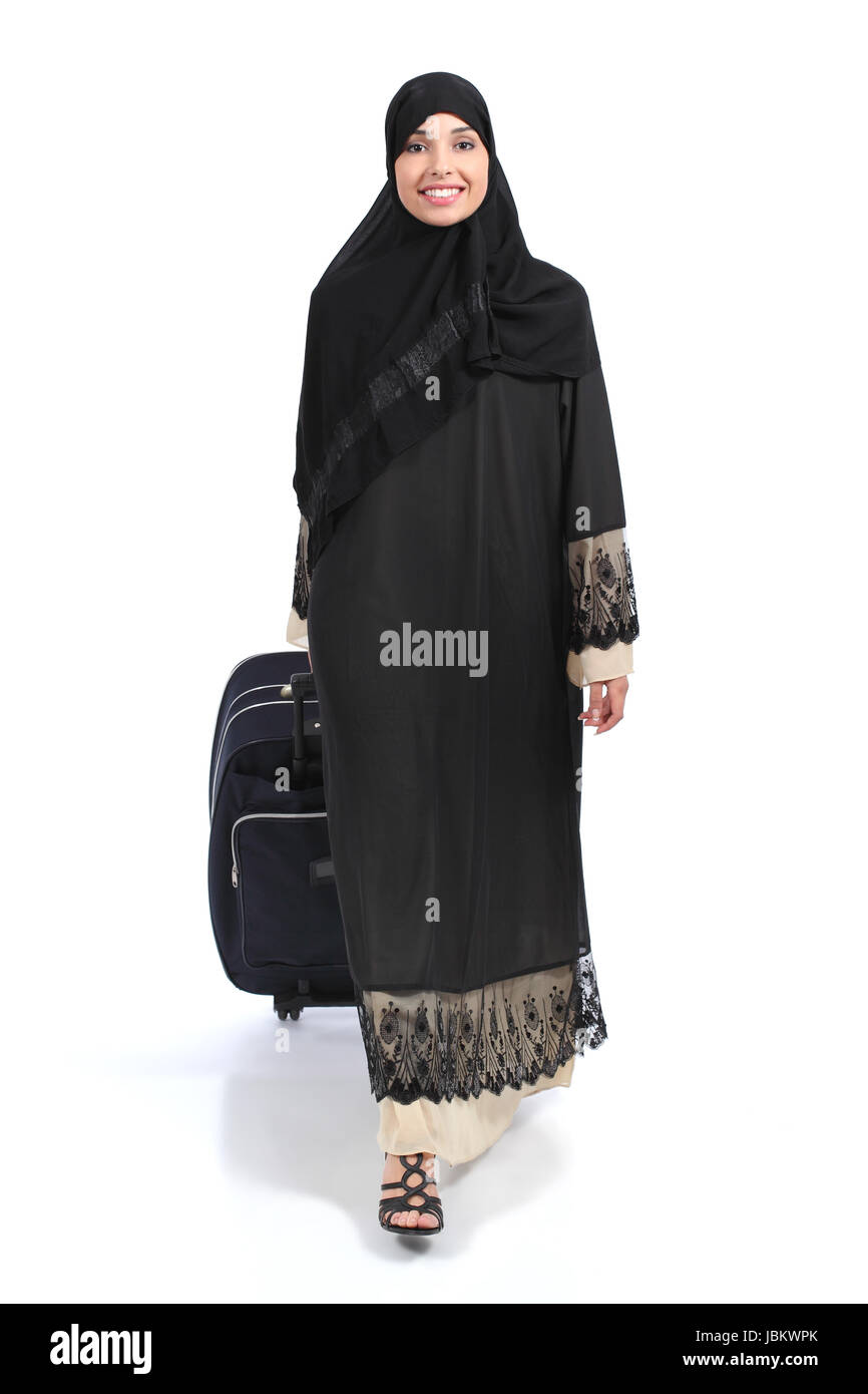 Full body of an arab saudi woman traveler walking isolated on a white background - Stock Image