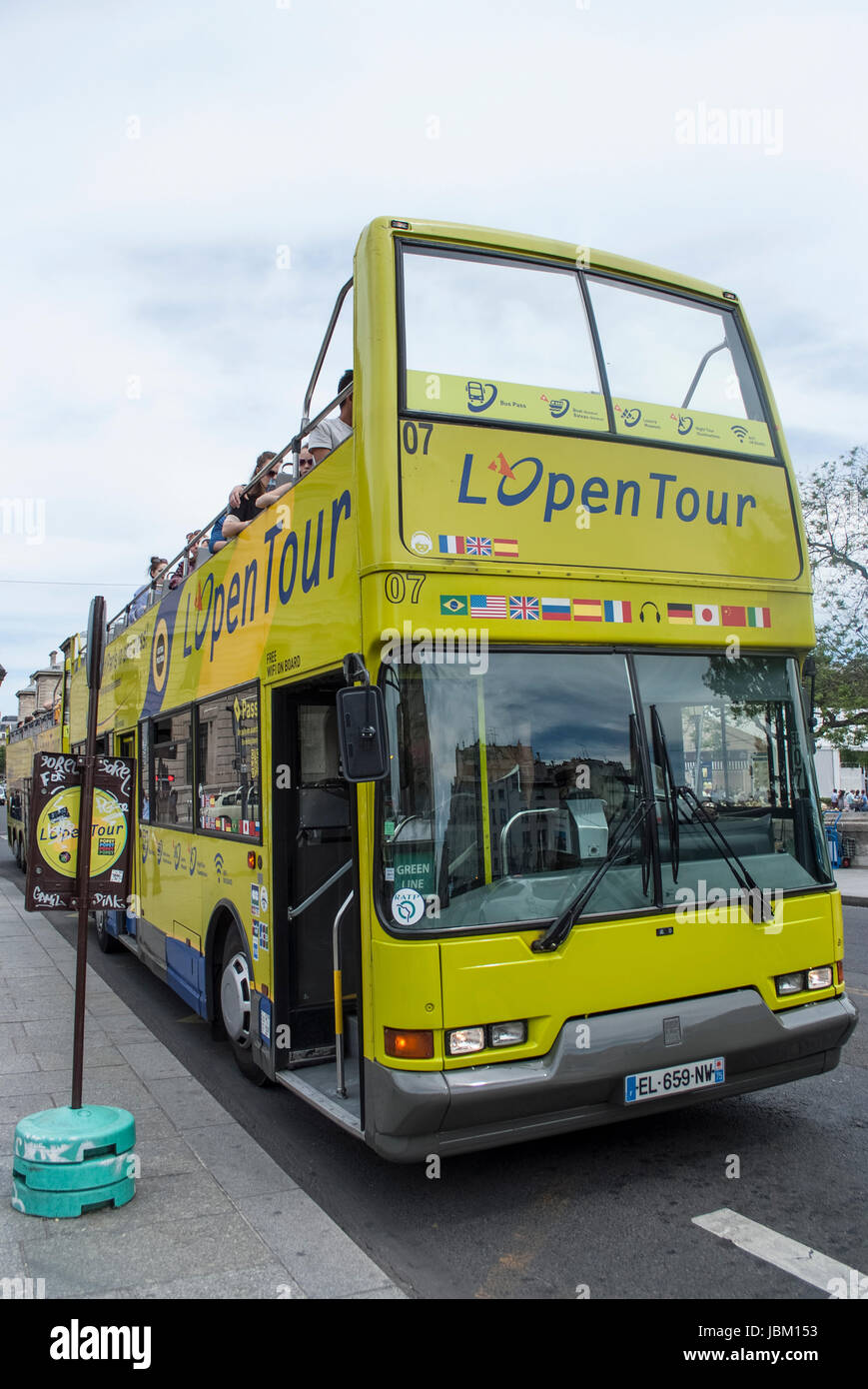 PARIS FRANCE OPEN TOUR BUS  OFFERING A WAY TO SEE THE MOST WELL KNOWN MONUMENTS OF THE CITY - PARIS BUS - PARIS - Stock Image