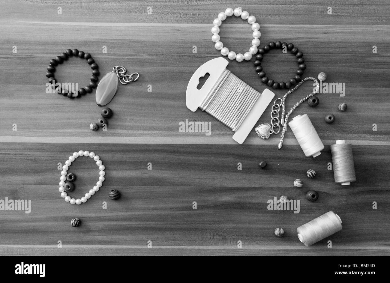 Beads, pearls, thread and string for handcrafting - Stock Image