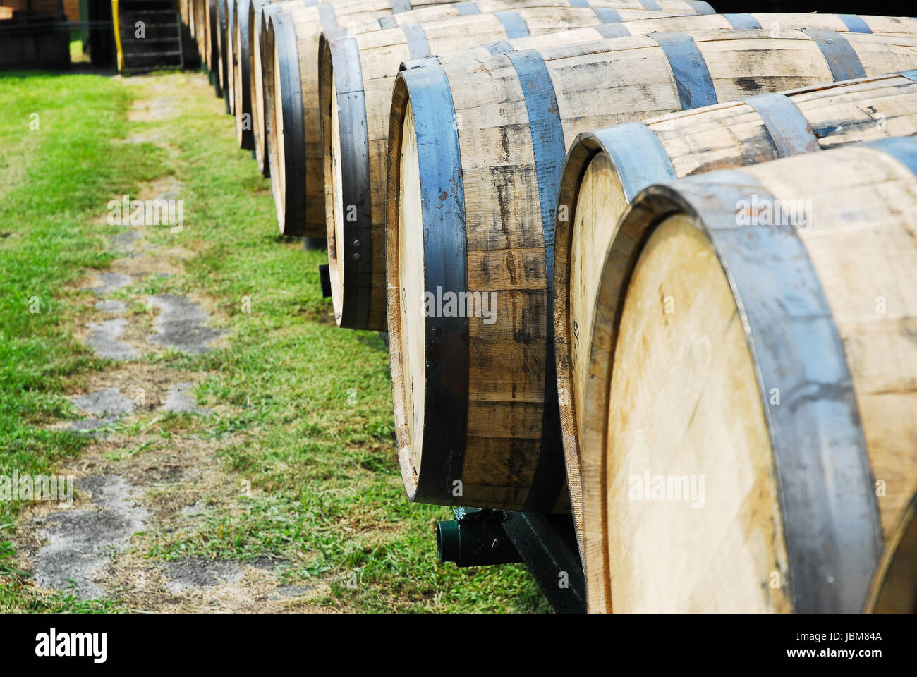 Barrels used for aging bourbon whiskey at a distillery in Kentucky. - Stock Image