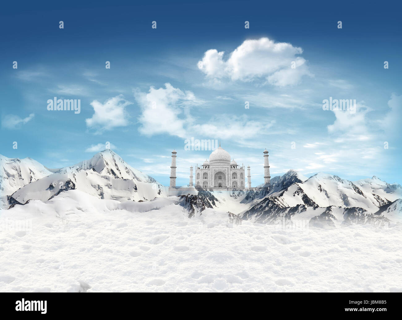 Taji Mahal among the mountains with snow and blue sky with clouds in the background - Stock Image