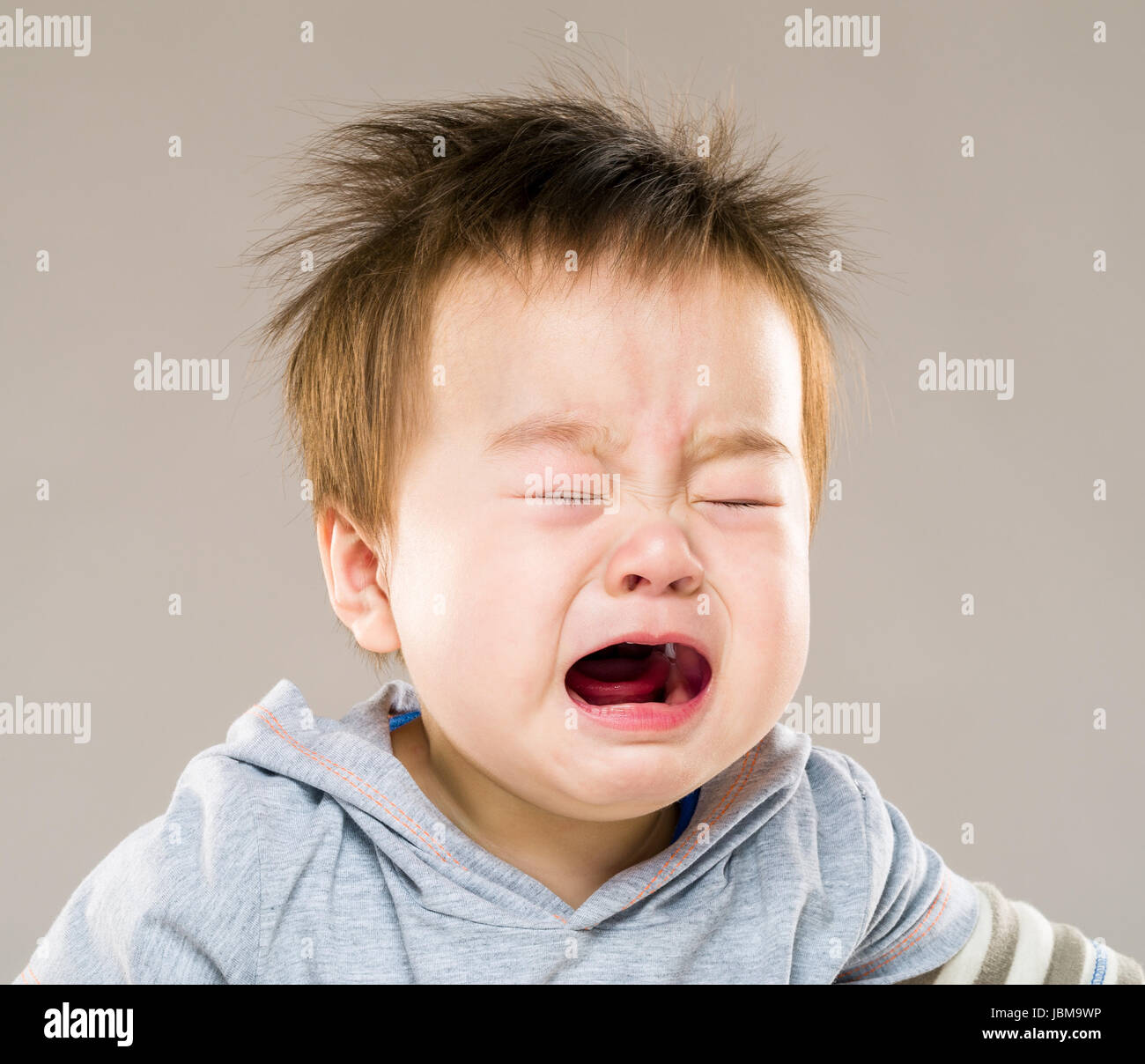 Crying baby boy - Stock Image