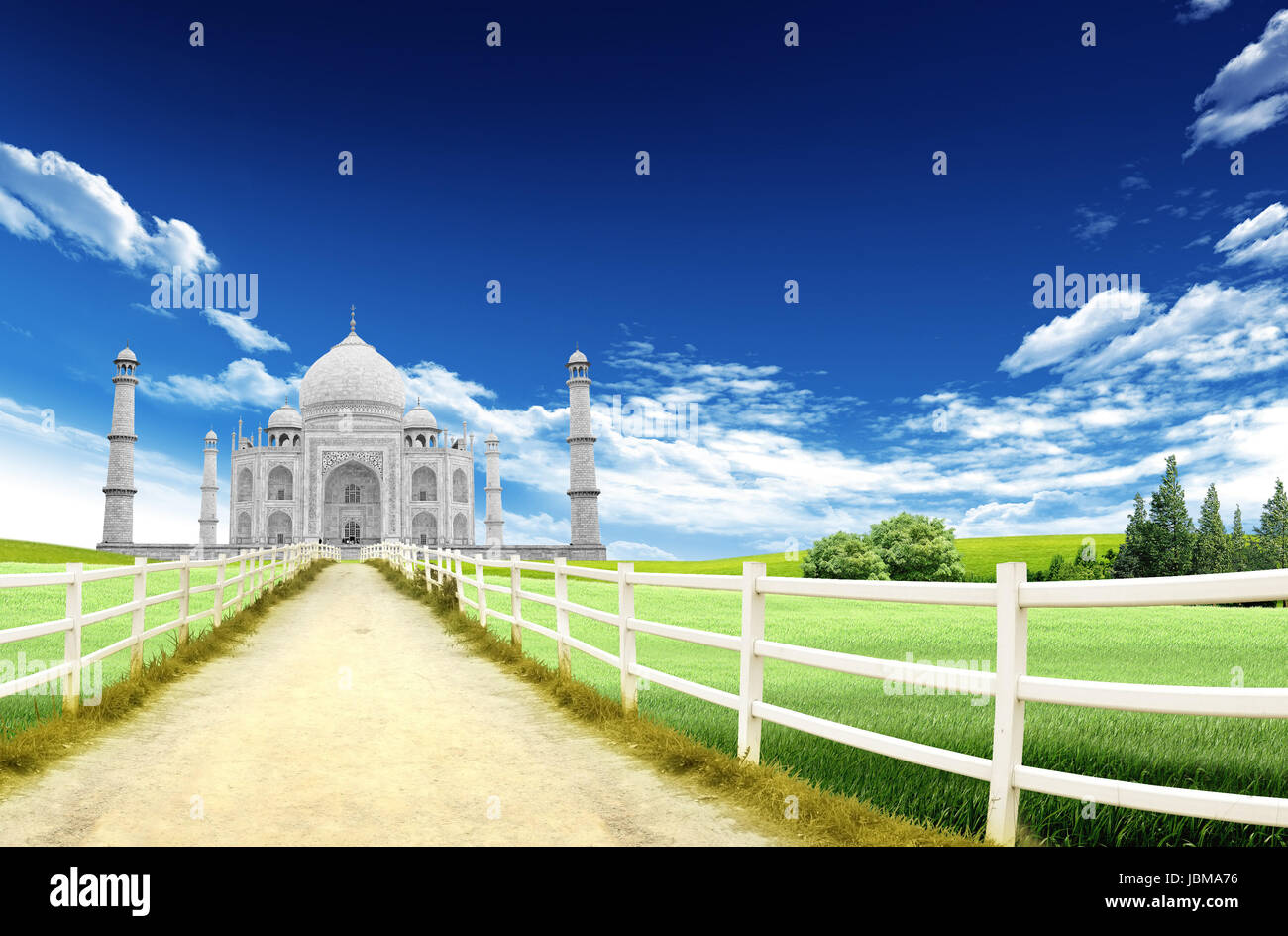 Landscape with country road and Taji Mahal, Agra landmark, India, in the background with blue sky and clouds - Stock Image