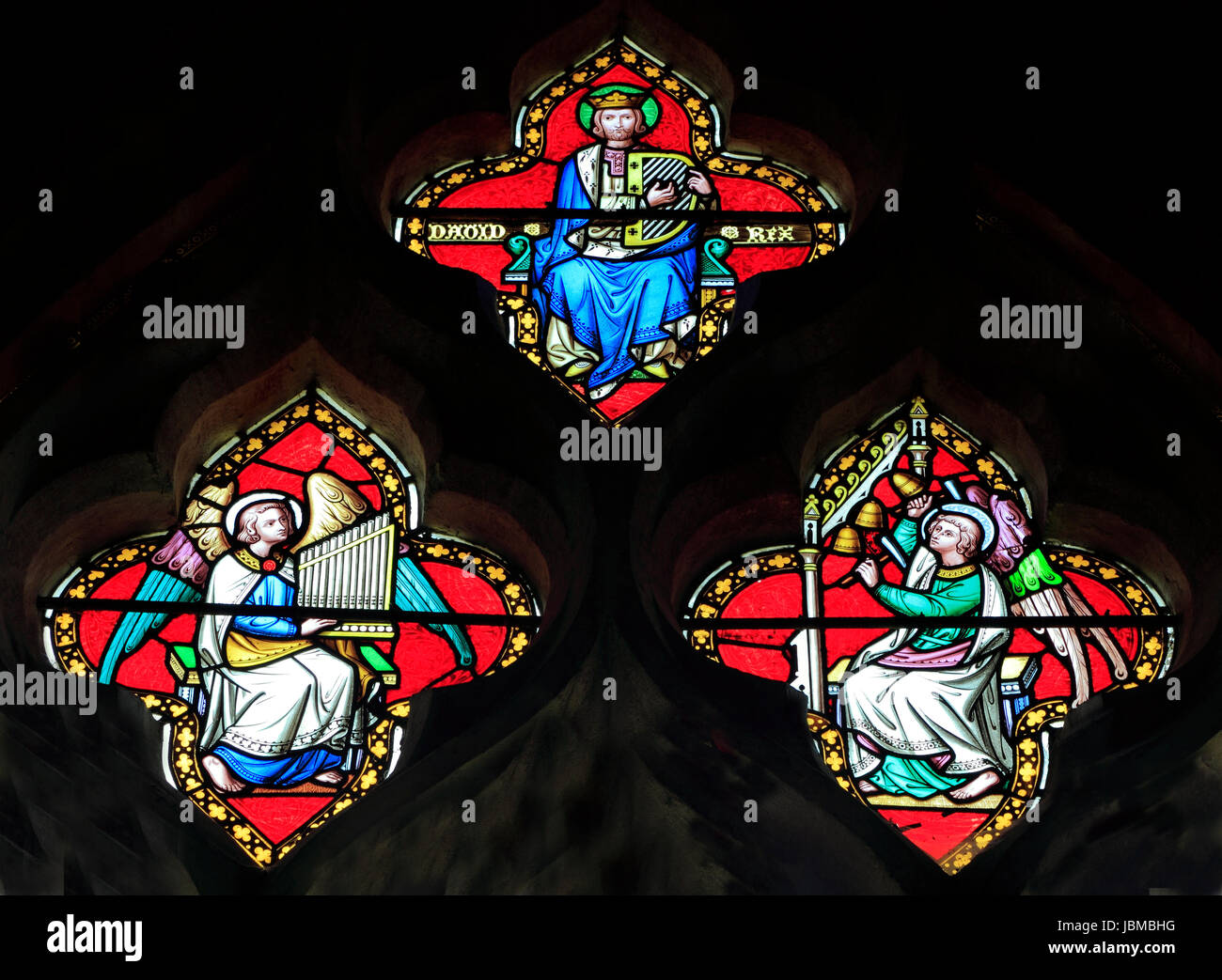 King David, 2 angels with musical instruments, stained glass window by Didron of Paris, 1860, Feltwell church, Norfolk, - Stock Image