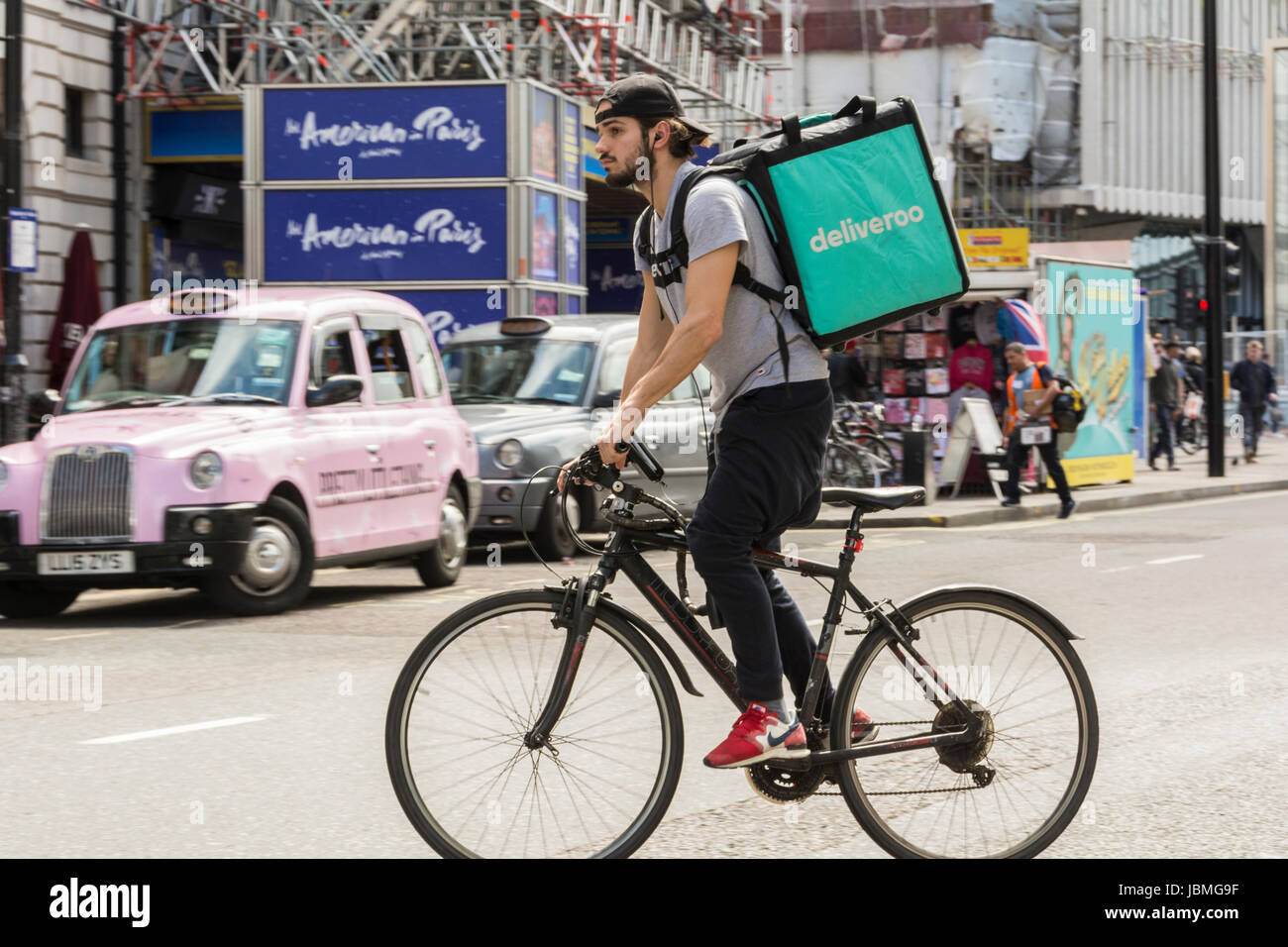 A Deliveroo cyclist on his bike in central London, UK Stock Photo