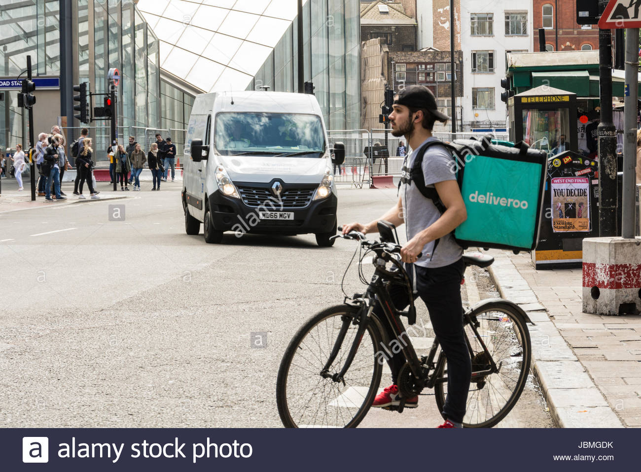 A Deliveroo driver on his bike in central London, UK - Stock Image
