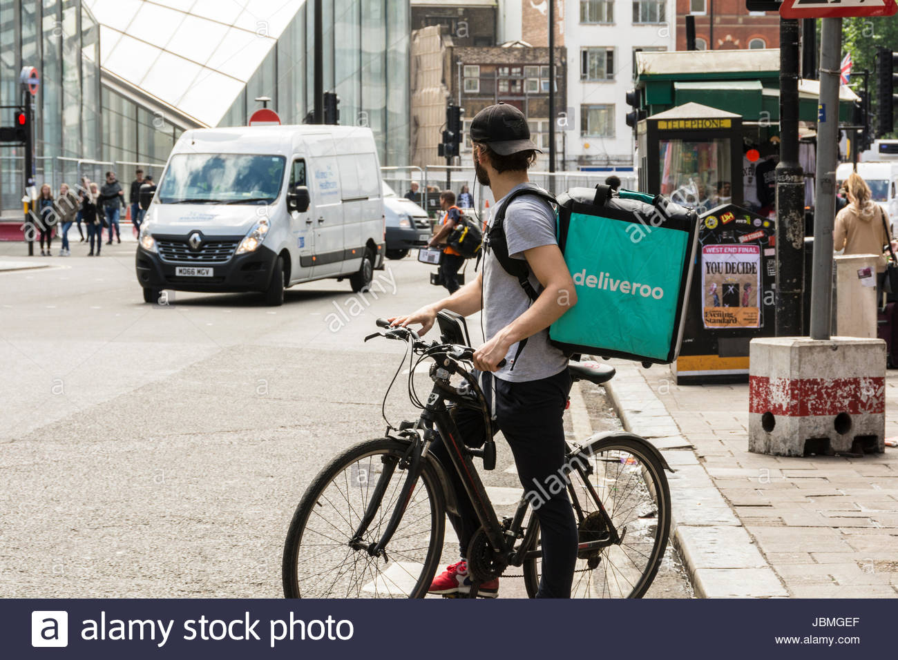 A Deliveroo driver on his bike in central London, UK Stock Photo