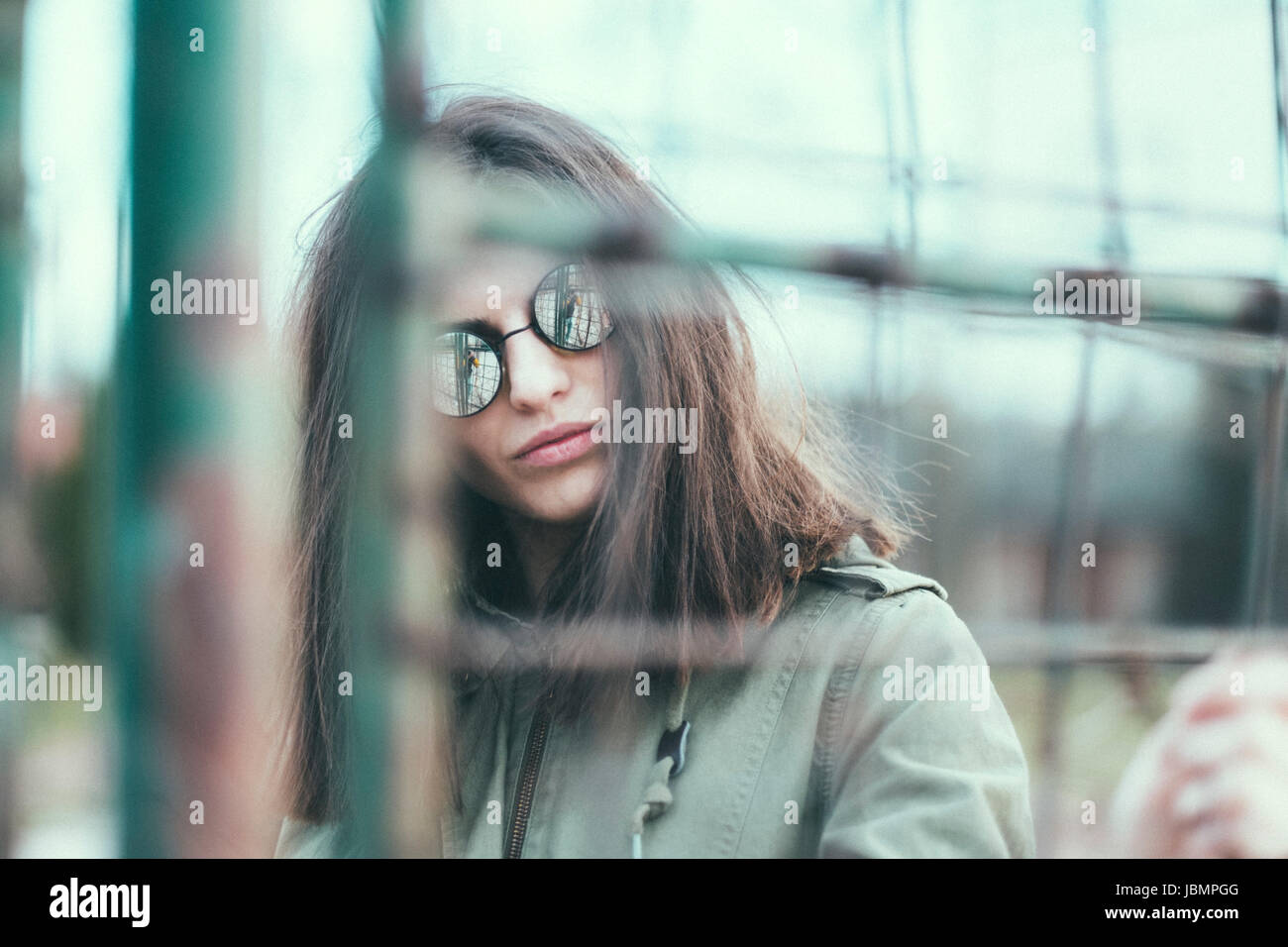 Woman at wire fence Stock Photo