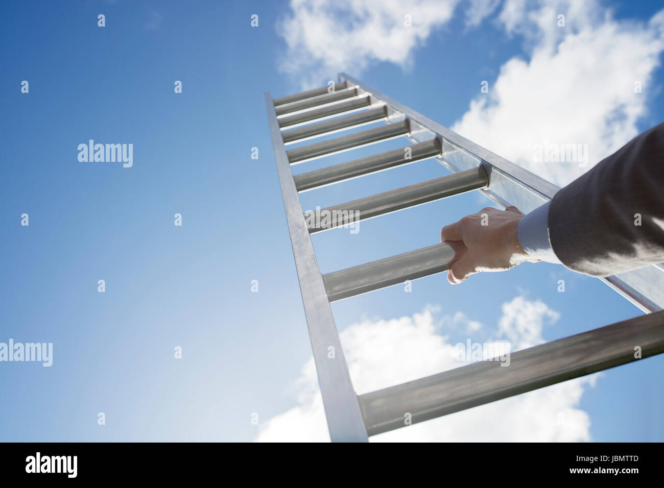 Businessman climbing the corporate ladder of success - Stock Image