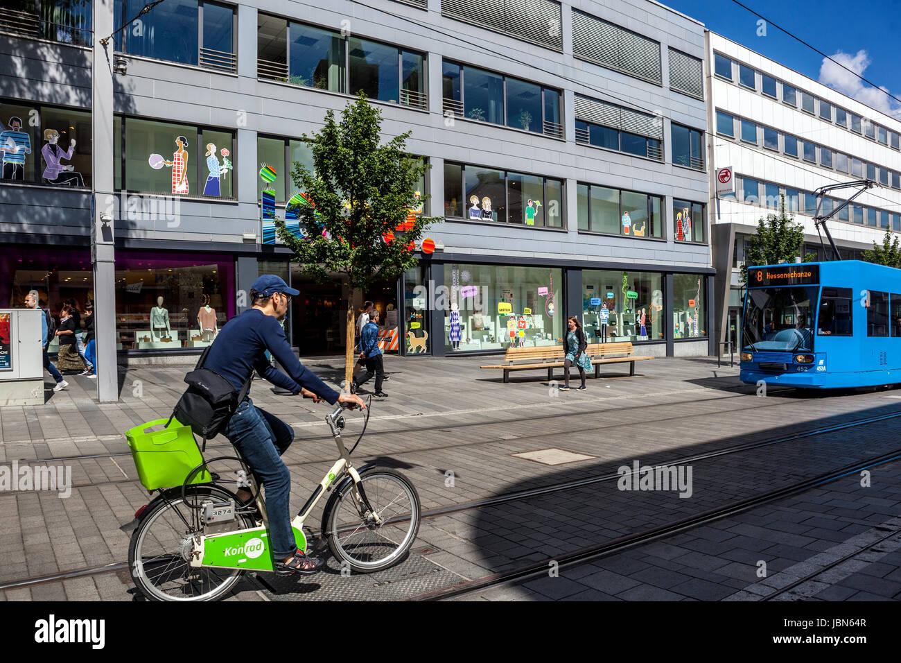 Konigstrasse. biker and tram, Kassel, Hessen, Germany - Stock Image