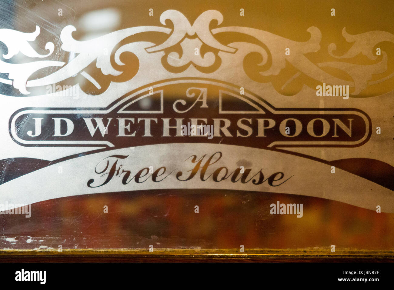 Sign / signage at The Benjamin Satchwell Wetherspoon / Wetherspoons Free House / Public House. 112-114 The Parade, - Stock Image