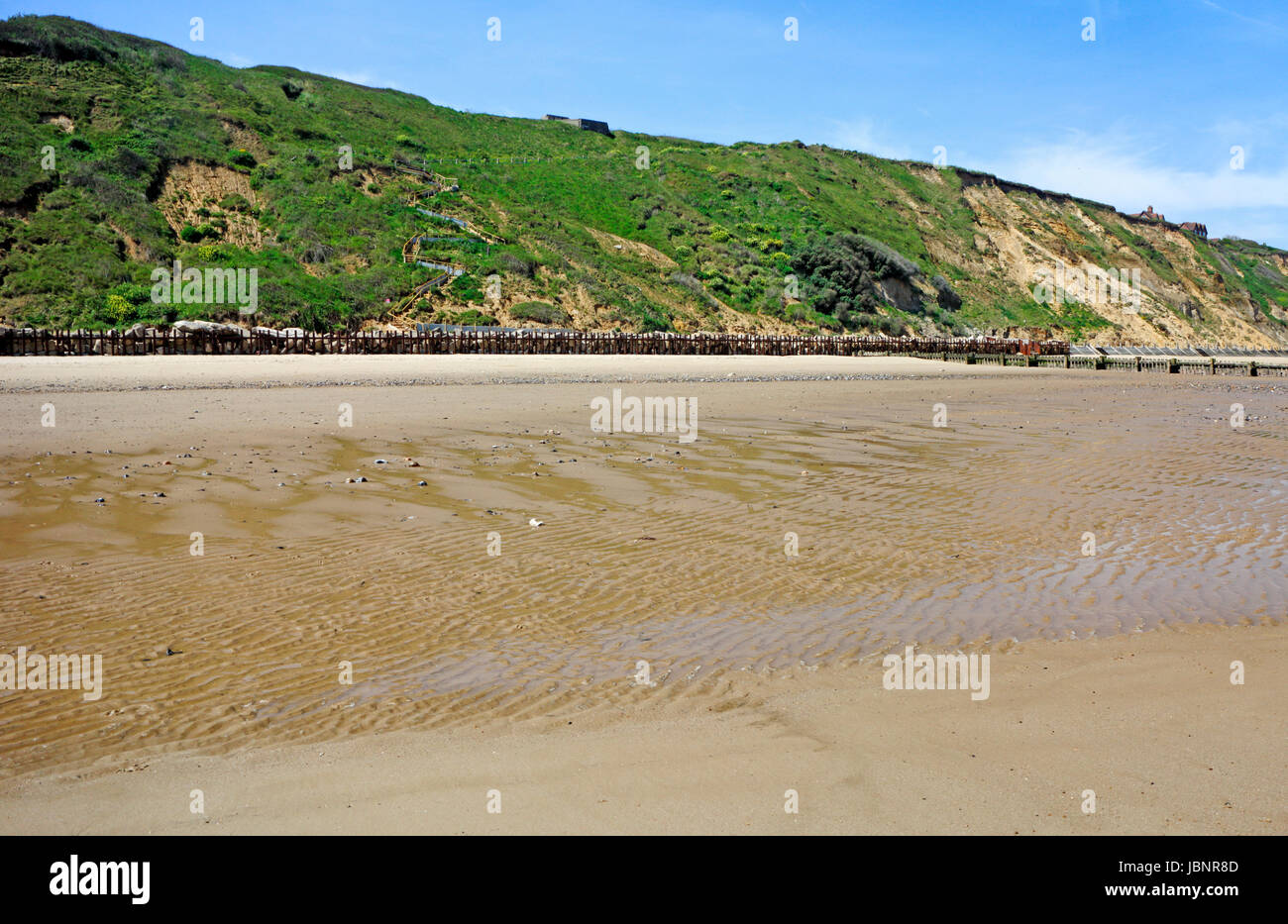 A view of the west beach and cliffs on the North Norfolk coast at Mundesley-on-Sea, Norfolk, England, United Kingdom. - Stock Image