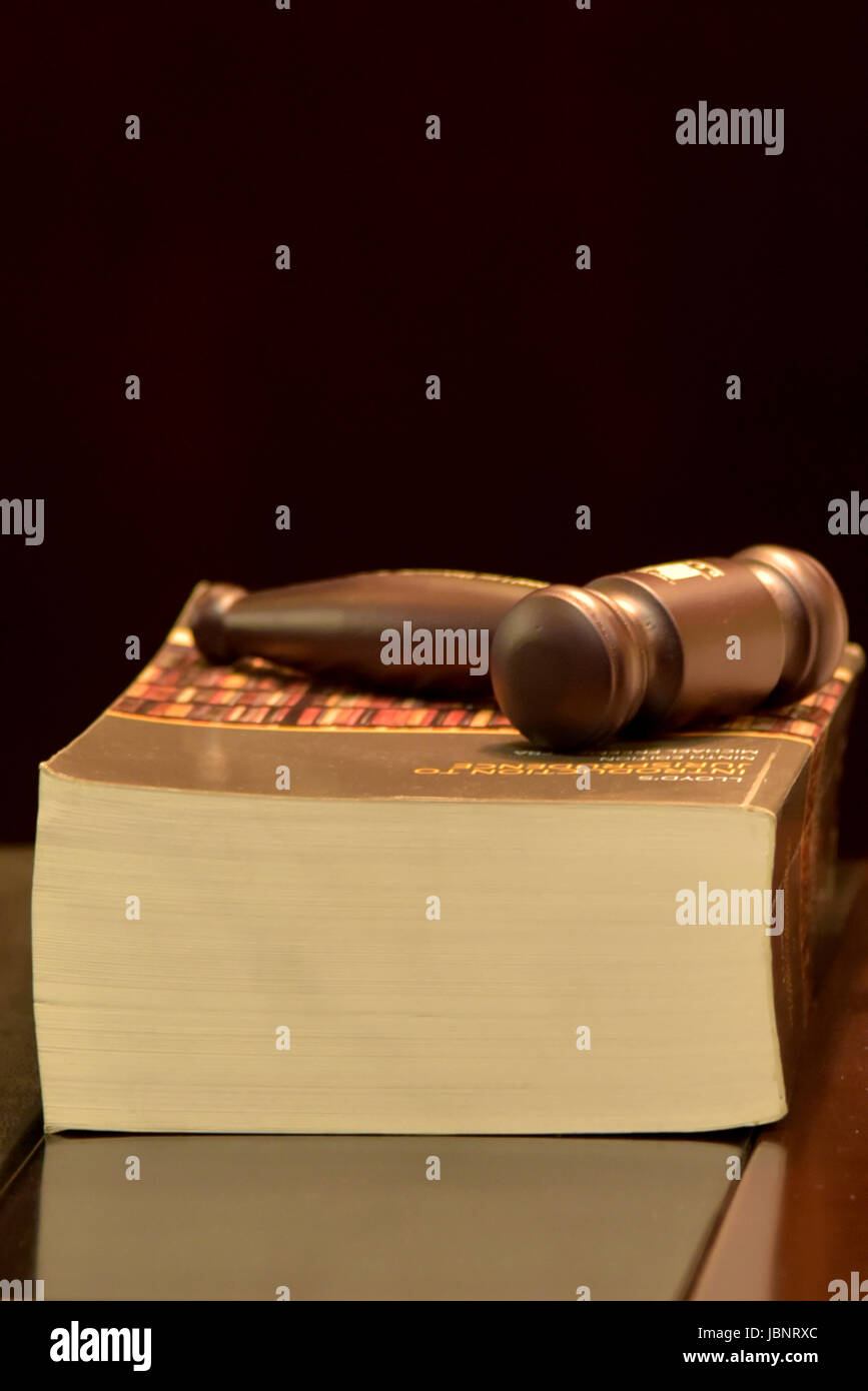 Hammer on top of law book - Stock Image