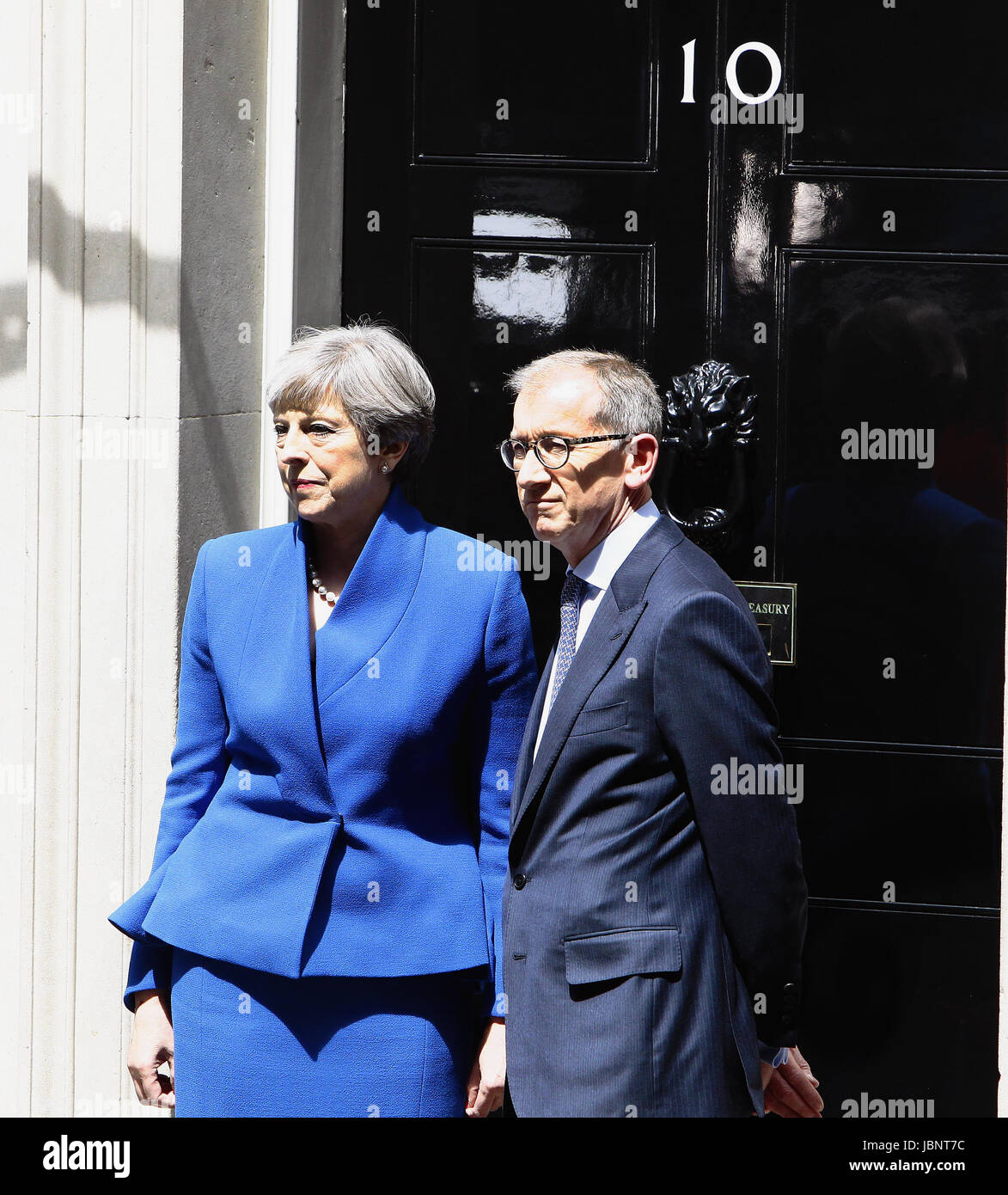 England, London, Theresa May in Downing Street after the 2017 election with husband Philip May on the steps of number Stock Photo