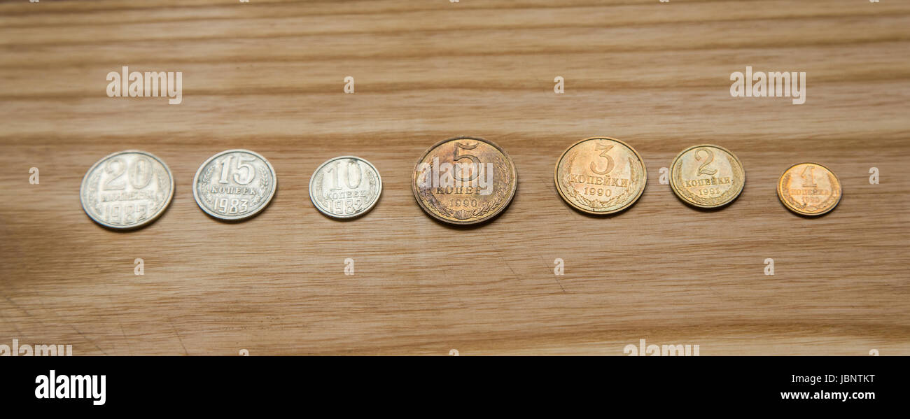 Old soviet couns on a wooden background. Hisoric, used currency. - Stock Image