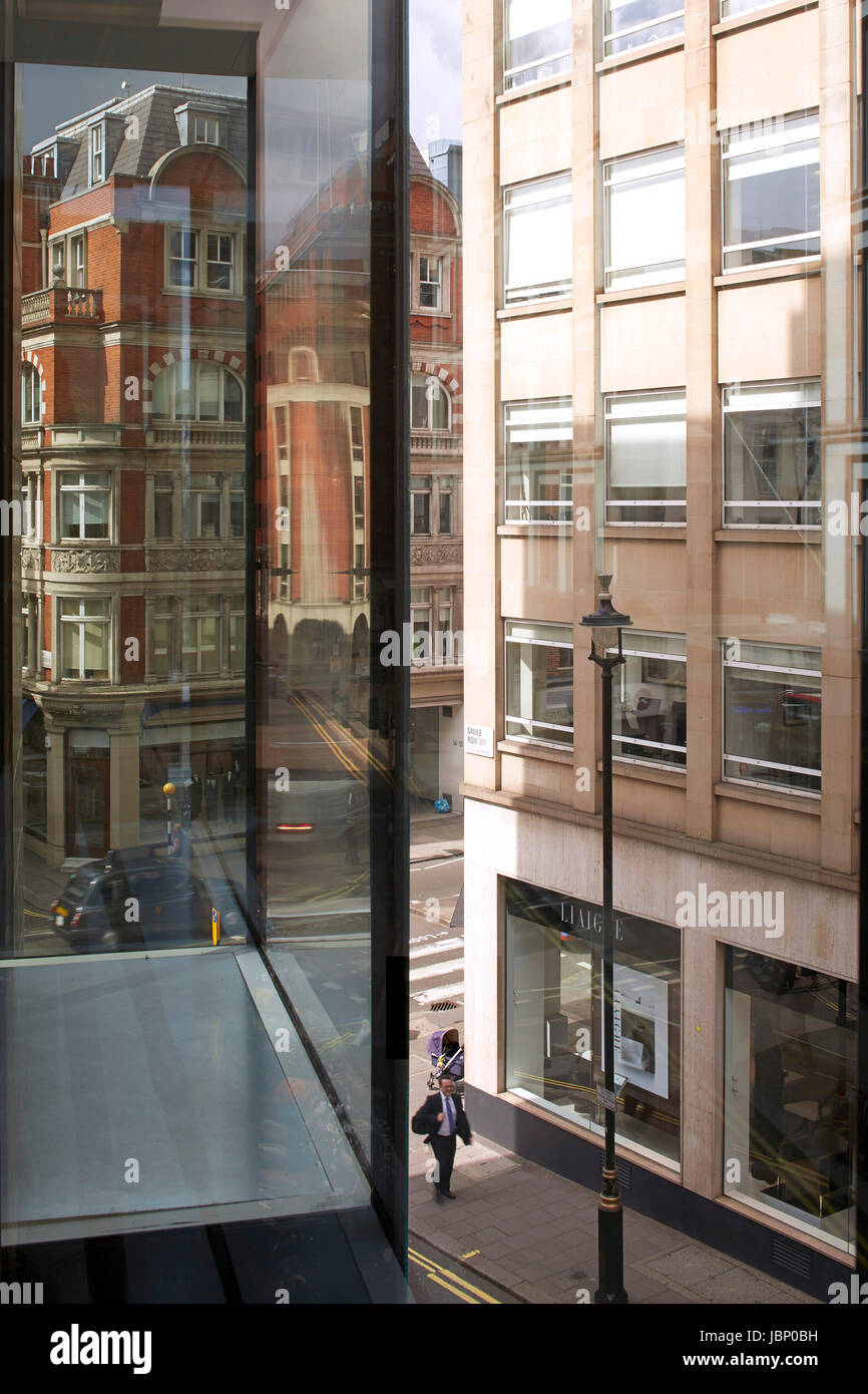 Interior view looking out onto Saville Row. 24 Saville Row, London, United Kingdom. Architect: EPR Architects Limited, - Stock Image