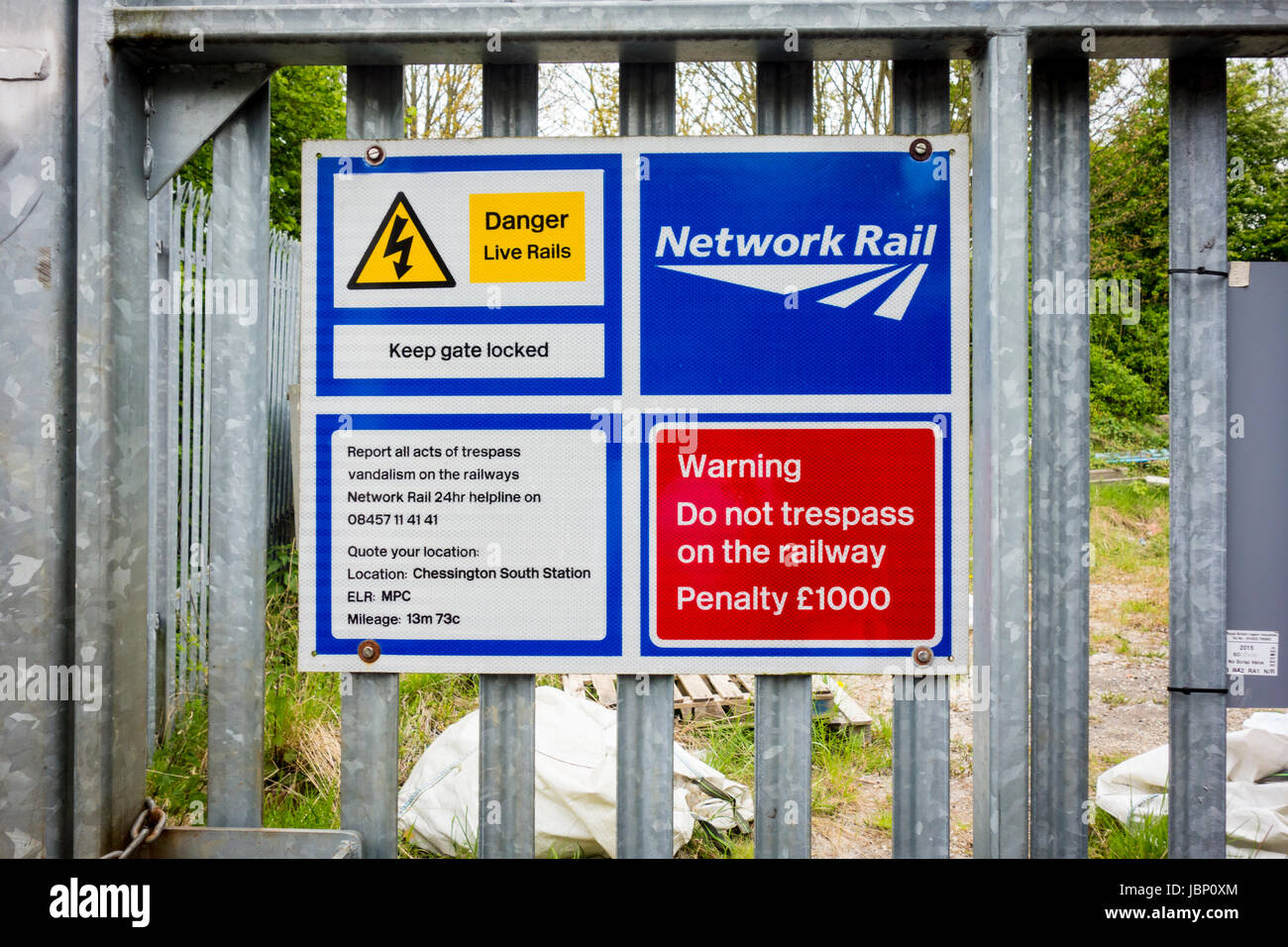 Network Rail warning sign on a fence. Danger Live Rails, do not trespass on the railway. UK - Stock Image