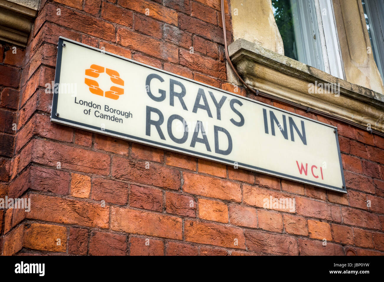Grays Inn Road street sign on the side of a brick building, London Borough of Camden, London, UK - Stock Image