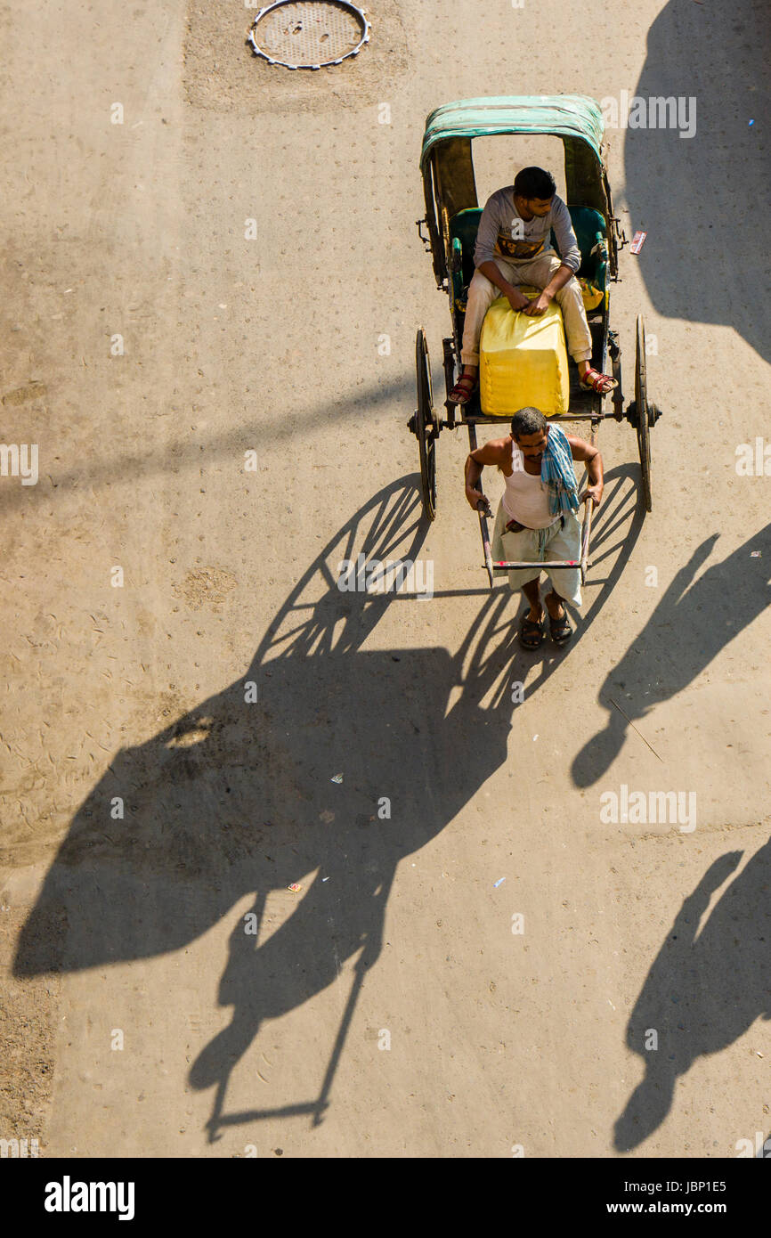 Aerial view on a man pulling a rickshaw on a road in the suburb New Market - Stock Image