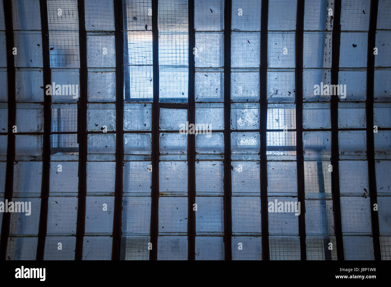 Industrial ceiling skylight of wire mesh reinforced glass panes and ...