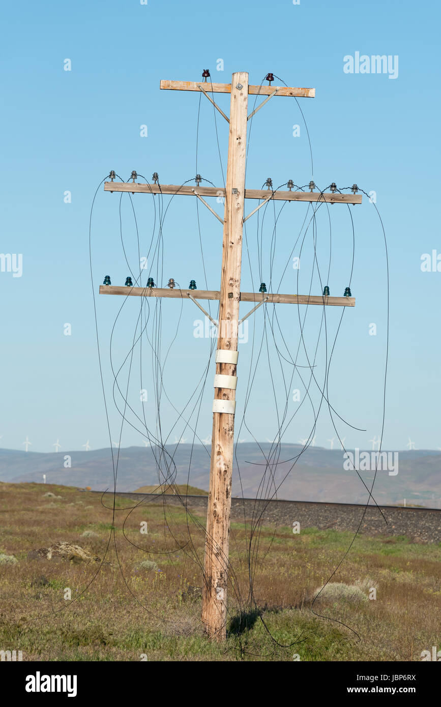 Trackside pole with dangling communications wires, Oregon. Stock Photo