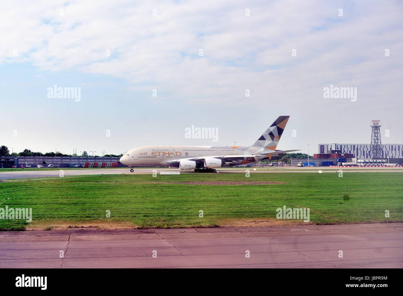 An Etihad Airways jet taking off at London's Heathrow International Airport one of the busiest airports in the - Stock Image