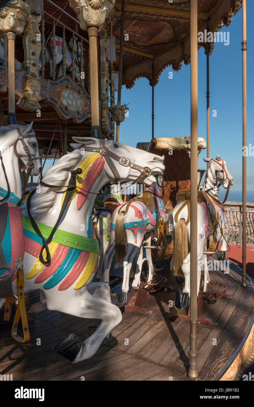 Ride on a century old carousel at Tibidabo Amusement Park provides breathtaking panoramic views of Barcelona - Stock Image