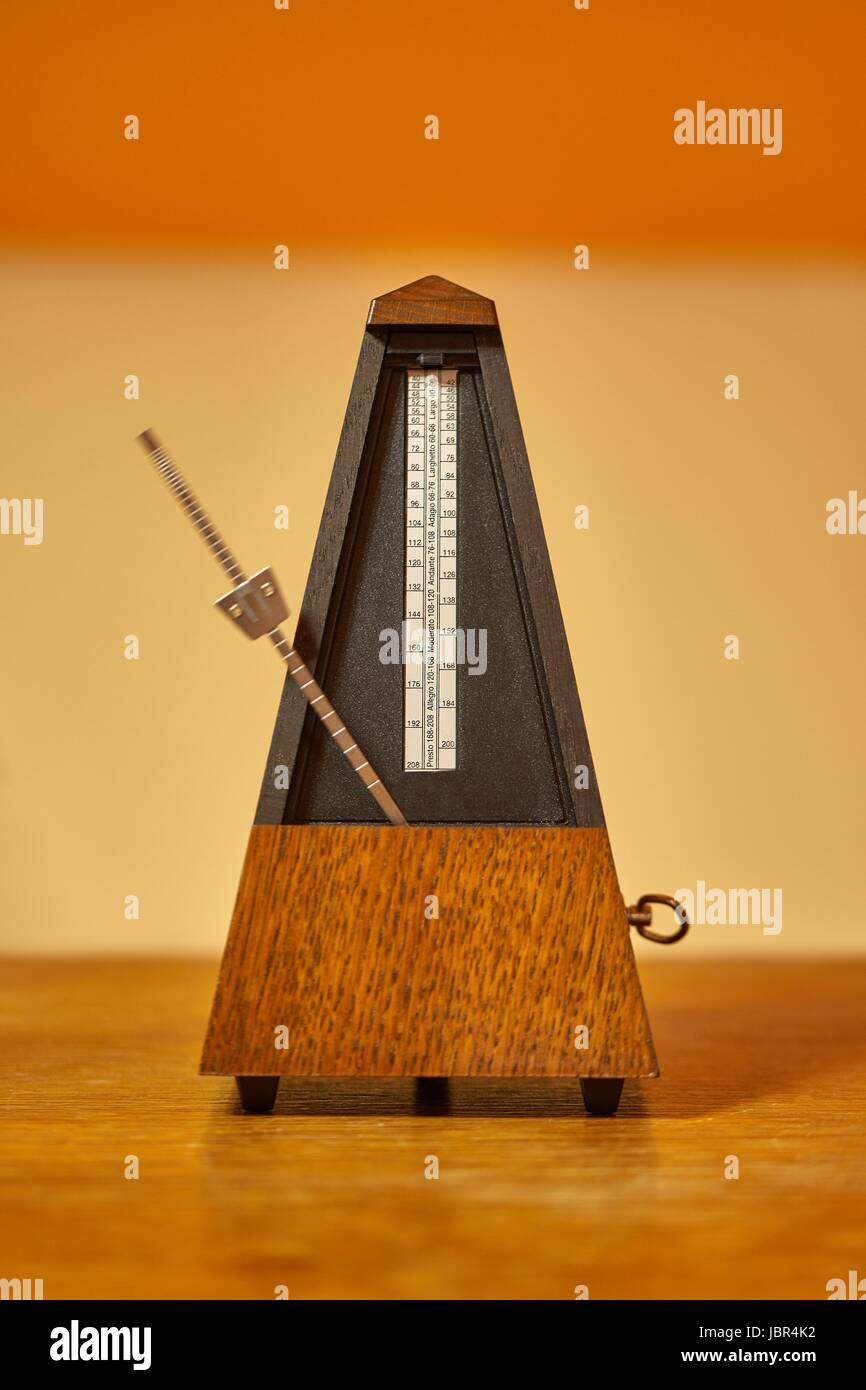 Classic metronome in a room with warm tone - Stock Image