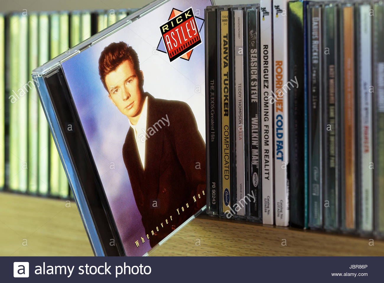 Whenever You Need Somebody, 1987 Rick Astley CD pulled out from among other CD's on a shelf, Dorset, England - Stock Image