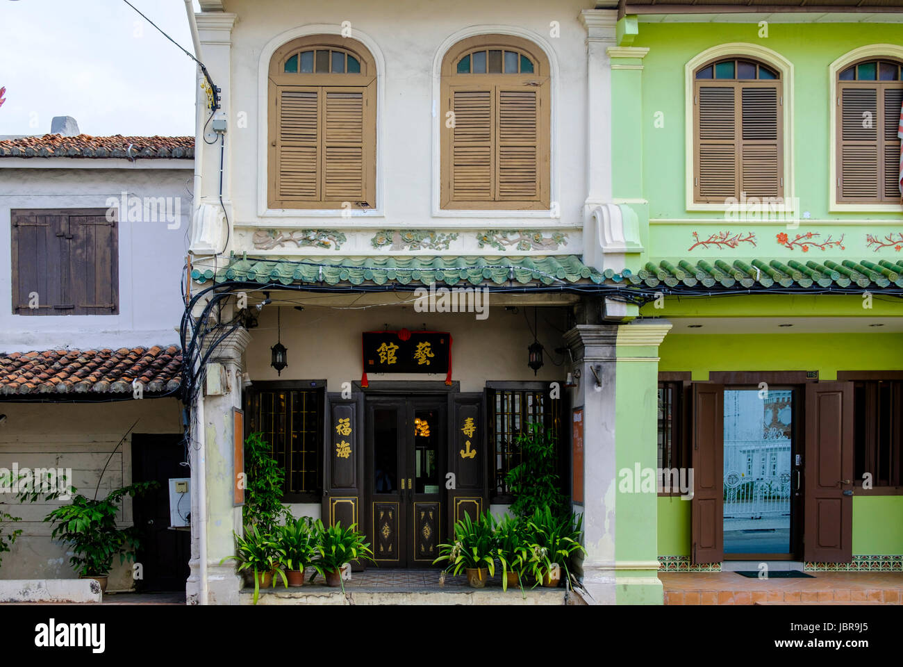 Front of a typical Peranakan-style (Baba-Nyonya, or Straits Chinese) shophouse mixing Chinese and colonial architectural - Stock Image