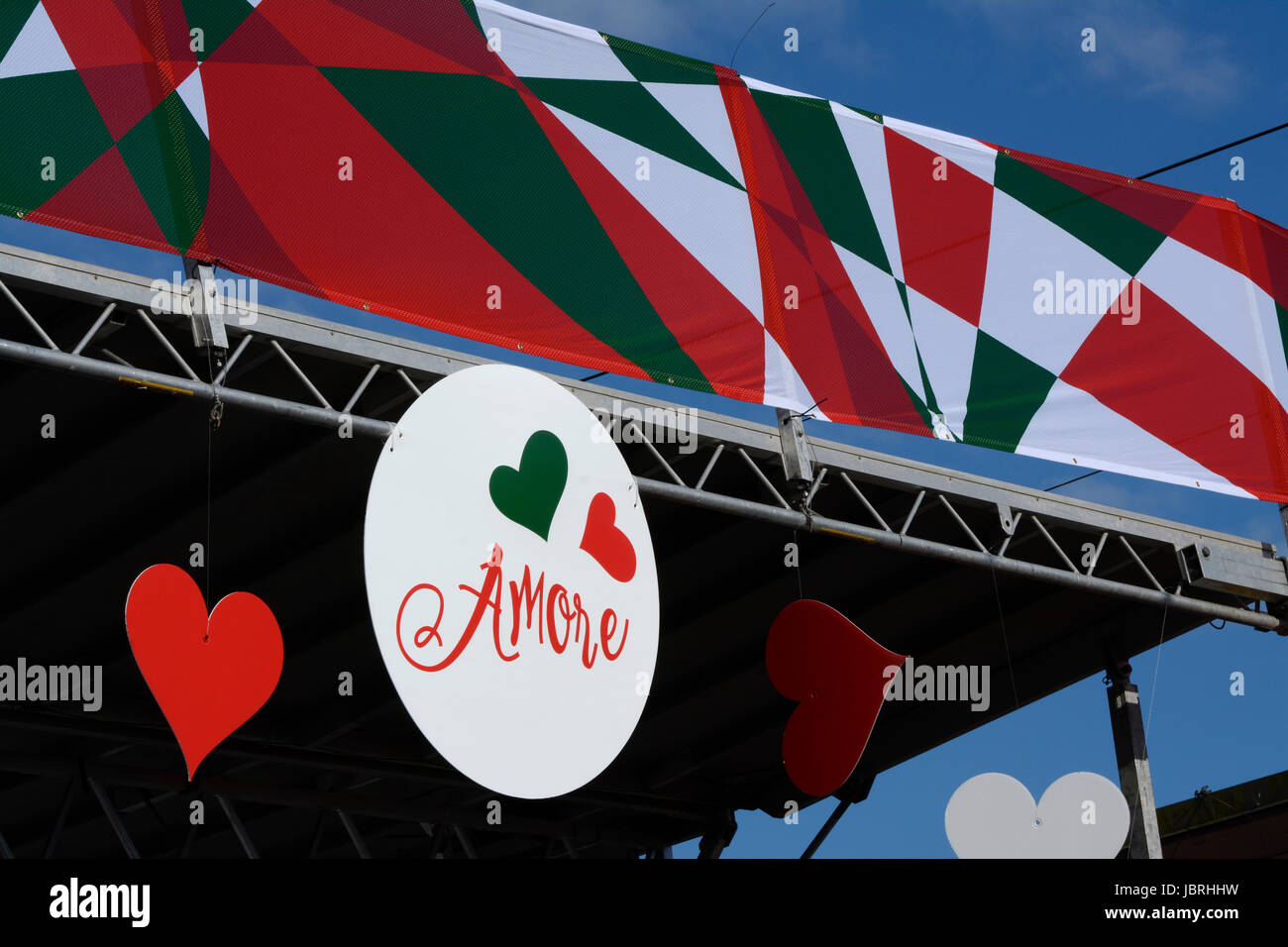 Vancouver, BC, Canada. 11th June, 2017. Hearts and he words 'Amore' adorn the  stage at 'Italian Day - Stock Image